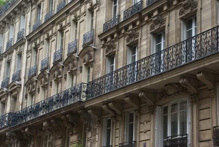 Facade of classic apartment buildings in Paris