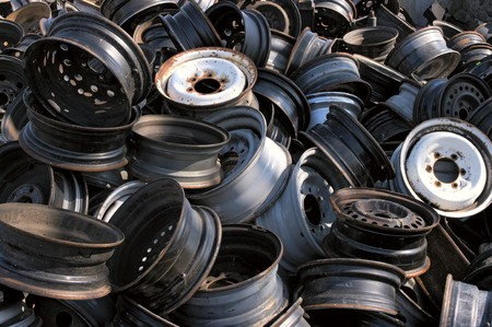 A pile of wheels in a junkyard