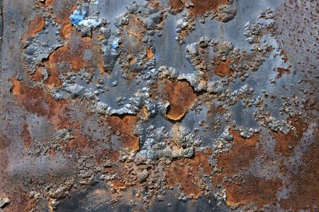 gouged: Old and rusted metal plaque