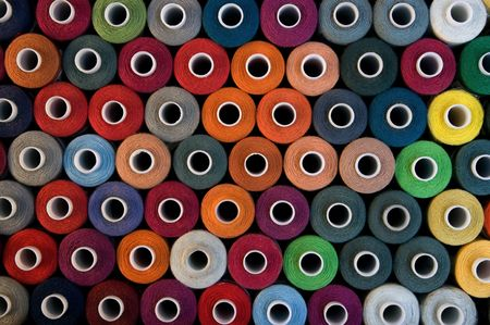 nylon string: A background with bobbins display Stock Photo