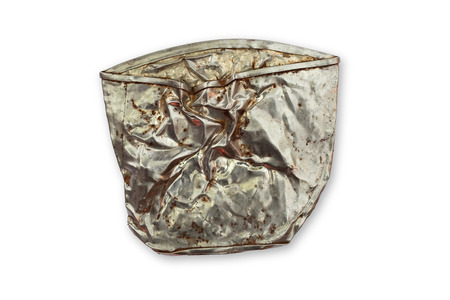 Studio shot of isolated crushed tin can with clipping path on white background photo