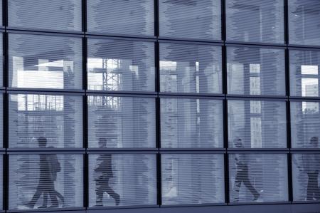 Businessmen walking in a hallway photo