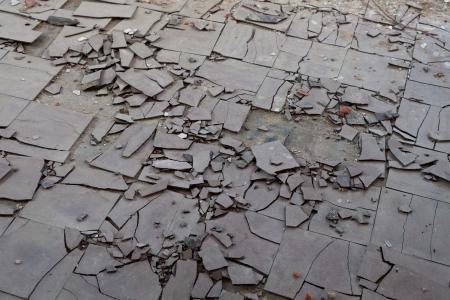 Old and broken asbestos floor tiles Stock Photo