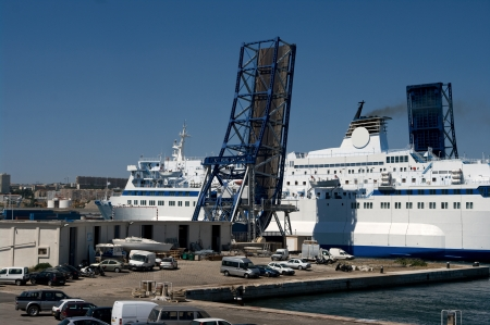 drawbridge: A passenger ferry in Marseille leaving the port and passing under an elevated drawbridge