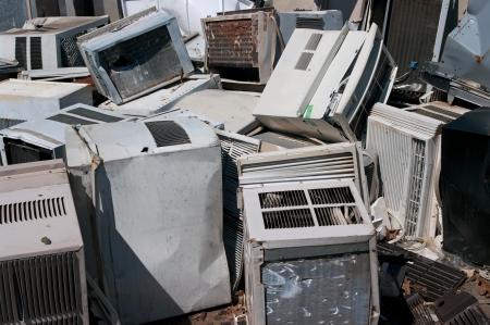 Dumped AC units in a scrapyard 스톡 콘텐츠