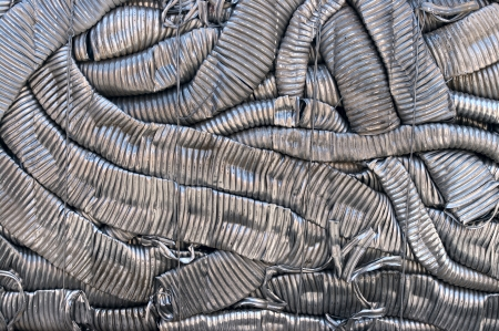 compressions: A bale of compressed aluminum coils
