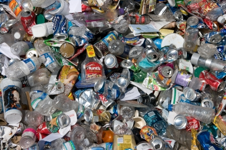 A pile of cans and plastic bottles to be sorted for recycling - In the US