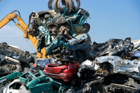 pile engine: Crushed cars in a junkyard Stock Photo