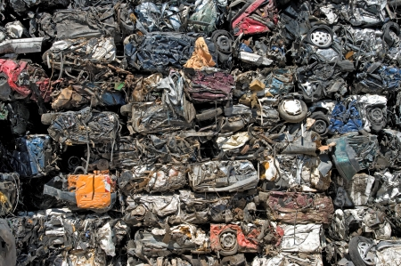 A stack of crushed cars for metal recycling Standard-Bild