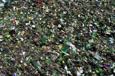 recycling center: A pile of green crushed glass for recycling. Glass is gathered by color.
