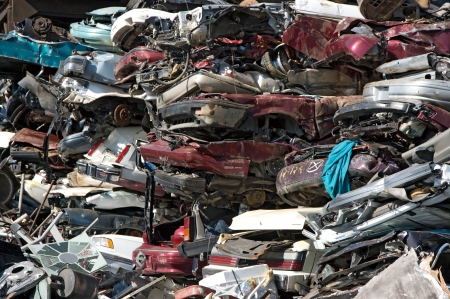 A pile of compressed car going to be shredded