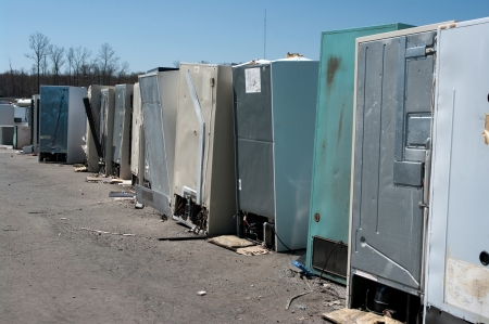 Row of old fridges for recycling