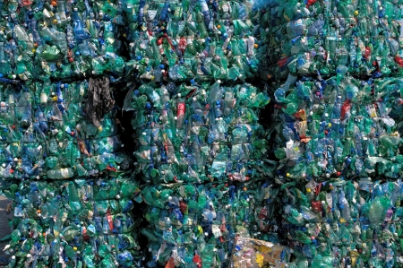 TOULOUSE, FRANCE - CIRCA 2009: Bales of green plastic bottles stacked at an undisclosed recycling facility circa 2009 in Toulouse. The plastic is gathered by color and type to be recycled. Editorial