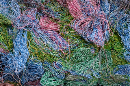 compressions: A bale of recycling telephone cables. There is a mix of plastic and copper to recover.