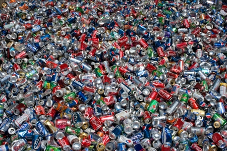 Aluminum cans lie in a heap, they will be compressed and baled
