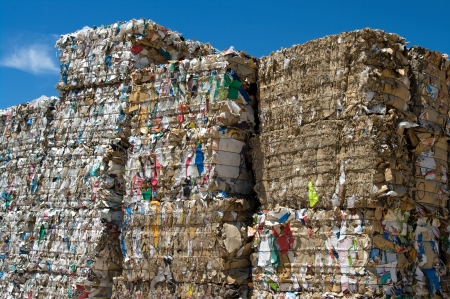 dump yard: Stacked paper bales for recycling