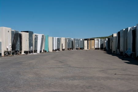 Row of old refrigerators for recycling photo
