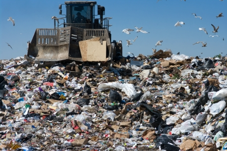 Truck moving trash in a landfill