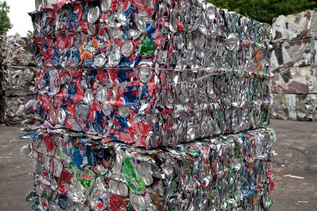 Bundled bales of cans in a recycling center 에디토리얼