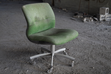 urban decline: Urbex - Abandoned office chair in an abandoned building, in light HDR processing