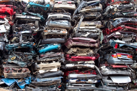Stacked crushed cars going to be shredded in a recycling facility 스톡 콘텐츠