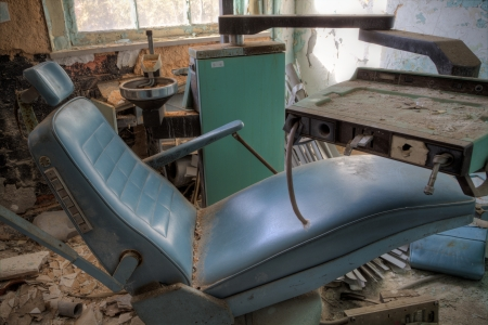 Urbex - Broken dentist chair in an abandoned hospital, in light HDR processing