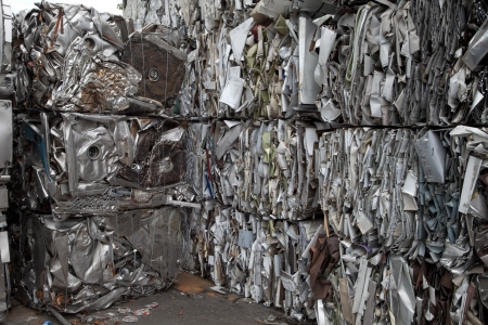 discarded metal: Piles of scrap metal bundled in cubes for recycling Stock Photo