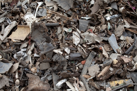 shred: Closeup of plastic pieces from separation process between plastic and metal from shredded cars in recycling center