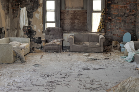 Urbex, abandoned house interior with cracked asbestos tiles, in light HDR processing