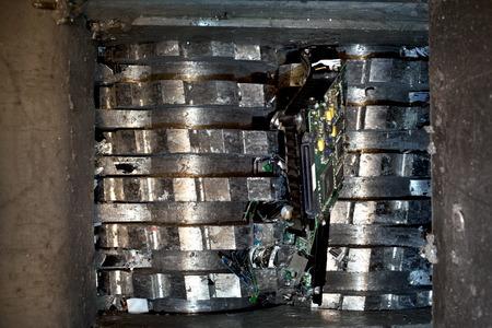Hard drive crusher shredder used for sensitive data destruction