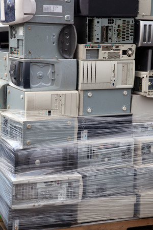 Stacked computers sorted and wrapped on a palette for electronic recycling
