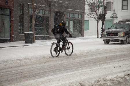 Biker struggling in snow of Winter storm on February 3, 2014 in Washington, DC