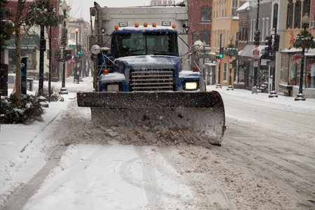 squall: Truck plowing Washington DC streets from the Winter storm on February 3, 2014