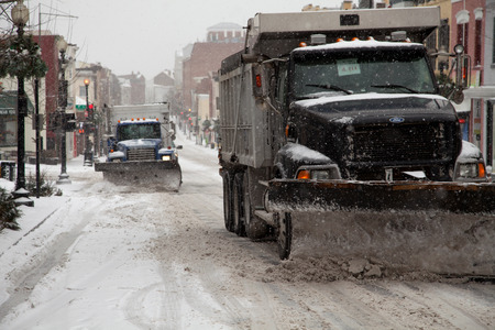 squall: Trucks plowing Washington DC streets from the Winter storm on February 3, 2014 Editorial