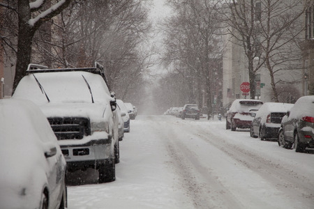 squall: Street of Georgetown in Washington DC under snow