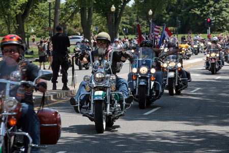 """defile: Motorcycles travel in DC as part of the annual Rolling Thunder motorcycle """"Ride for Freedom"""" for American POWs and MIA soldiers on May 25, 2014 in Washington, DC."""