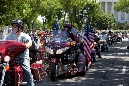 "Motorcycles travel in DC as part of the annual Rolling Thunder motorcycle ""Ride for Freedom"" for American POWs and MIA soldiers on May 25, 2014 in Washington, DC."