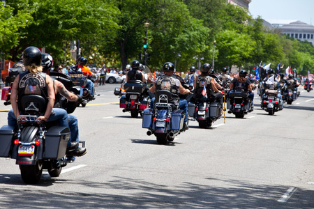 """Washington, DC, USA - May 25, 2014: Large group of motorcycles looping around the Mall in Washington DC as part of the annual Rolling Thunder motorcycle """"Ride for Freedom� for American POWs and MIA soldiers."""