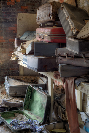 absence: Urbex - empty, old and dirty suitcases, in light HDR processing Stock Photo