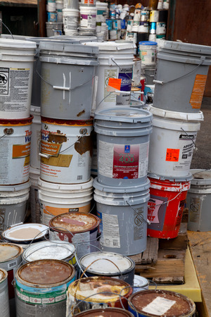 toxic waste: Fairfax, VA, USA - December 5, 2013: Paint cans gathered in order to be recycled. They will be sorted out and the latex ones will be separated from the oil cans. Unlike oil paints, latex paints arent considered hazardous waste and can be recycled with me