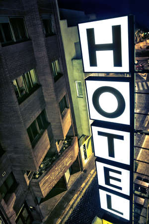 Illuminated hotel sign at night from a room Stock Photo - 14681343