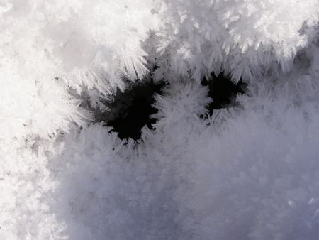 Eyes from snowflakes Stock Photo