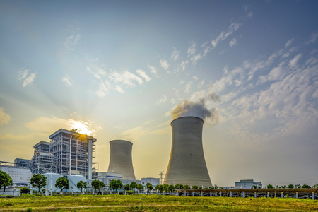 Nuclear power plant after sunset. Dusk landscape with big chimneys. Imagens