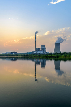 Nuclear power plant after sunset. Dusk landscape with big chimneys. Editorial
