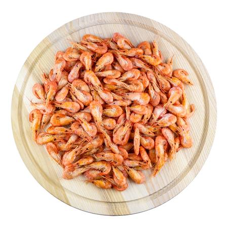 camaron: Gran cantidad de camarones en una tabla de madera Foto de archivo