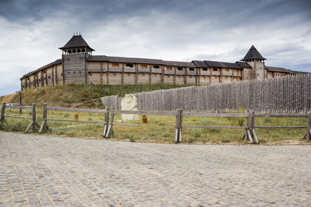 firmness: ancient wooden town surrounded by a fence