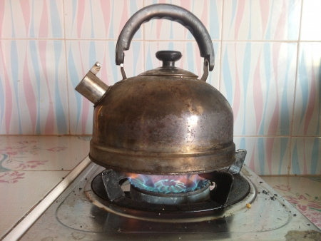 shiny metal: Kettle on the gas stove