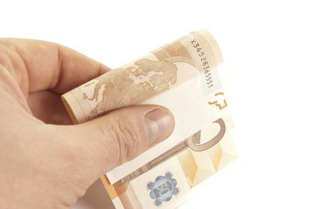 bankroll: bankroll in arm Stock Photo