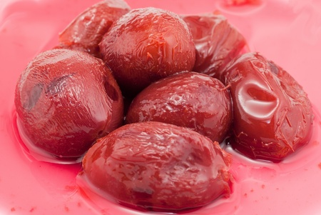 pickled plums with red  juice bakcground