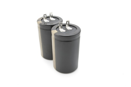 capacitor: Two black electrolytic capacitor for flash isolated on white